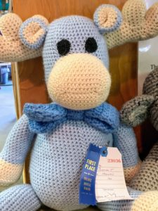 And here is a blue ribbon hand-knitted stuffed animal. Country fairs always have a long list of competition categories. It is fun to see all the submissions - all handmade with care.