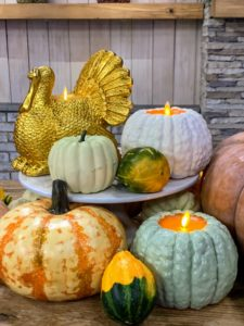 For a more fall theme, use my Flameless Harvest Gourd candles in pale orange, sage or white. These are about five-and-a-half inches tall and look great on a table among some other true gourds and pumpkins. Or use my Wax Turkey Figural Candle in ivory or this gold. These candles can be used from year to year - start your collection now!