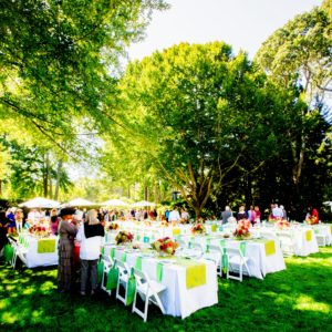 The tables were dressed in bright summer foliage green. Nearly 100-guests were in attendance. (Photo by ©Philippe Cheng)