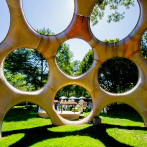 "And here is a view from inside Buckminster Fuller's Fly's Eye Dome. The Fly's Eye Dome. It features circular openings, called ""oculi,"" in a pattern similar to the lenses of a fly's eye, which would allow light and air to enter without compromising the integrity of the structure. (Photo by ©Philippe Cheng)"
