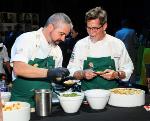 Chef Rick Bayless, on the right, was also there to make his tangy spicy scallop aguachile with summer melon. (Photo by Astrid Stawiarz/Getty Images)