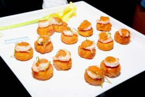 The evening started with some canapes. These are poached shrimp grits made by chefs from the Carolinas. (Photo by Astrid Stawiarz/Getty Images)