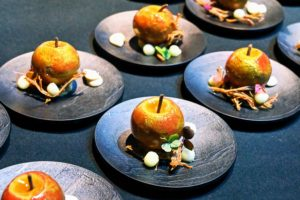 There were also several chef stations, where notable chefs presented some of their favorite bites. These are apples with brown butter mousse, apple confit and frozen Armagnac sabayon provided by chefs Eric Ripert and Thomas Raquel. (Photo by Astrid Stawiarz/Getty Images)