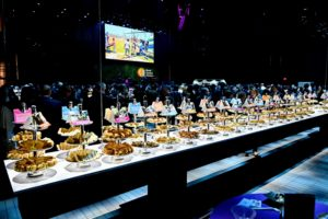 Tables with dishes from countries WCK has helped were lowered from above. (Photo by Astrid Stawiarz/Getty Images)