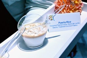 Here is a coconut panna cotta with dulce de leche sauce and toasted coconut flakes - a dish from Puerto Rico. (Photo by Astrid Stawiarz/Getty Images)