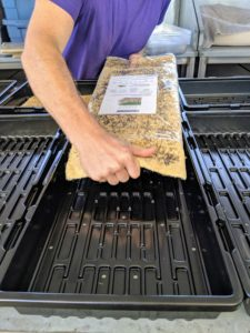 Here, Ryan uses some of the various pre-seeded grow mats, which fit perfectly into the cultivator trays.