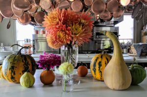 And here is a beautiful arrangement on my kitchen counter together with some of the gourds and winter squash picked from my garden. If lucky, these arrangements should last four to six days - they're so beautiful.