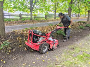The next step is to rototill the area. Rototilling is one method of turning up the soil before planting the garden. Pete uses a Barreto rototiller, which is designed to break up the hard, compact soil into loose, broken-up dirt that can then be used for planting.