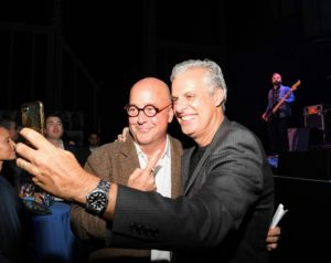 Here is a photo of Chefs Andrew Zimmern and Eric Ripert taking a selfie for their own social media platforms. (Photo by Dimitrios Kambouris/Getty Images)
