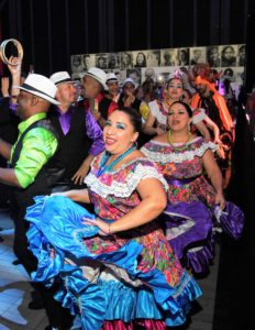 And a team of Puerto Rican dancers walked through the space as a 17-piece band played. (Photo by Dimitrios Kambouris/Getty Images)