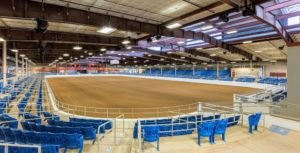 This is the Tony Nelssen Equestrian Center - a climate-controlled event space featuring a 120,000 square--foot Equidome with 3400 permanent seats surrounding a sunken arena.