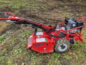 This is a Barreto Heavy-Duty Mid-Sized Tiller. On rear-tine tillers like this, wheels are standard operating equipment. This particular model has an 18-inch tilling width and uses hydraulics for easy maneuverability.