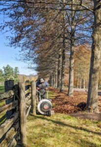 Here is Pete with the walk-behind gas leaf blower. This helps to move the leaves into one central location.