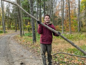 Here's Ryan moving another fallen branch in the woodland.