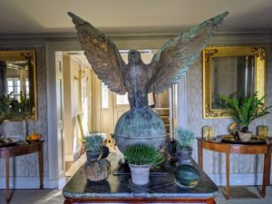 Final preparations for my dinner party were underway by late afternoon. I always decorate my home with lots of pretty houseplants whenever I entertain. In my foyer, houseplants and pumpkins share this table with my giant falcon.