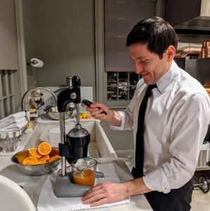 Here's Andres juicing oranges for the cocktails.