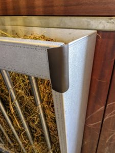 As an added precaution, we also affixed rubber bumpers to the corners so the horses don't hurt themselves when eating, or when rubbing up against the metal.