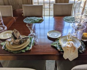 My housekeepers, Enma and Sanu, work with me to choose the table settings. We create a couple of options, set them on the table and see which one we like best. I wanted this dinner to have a country feel.