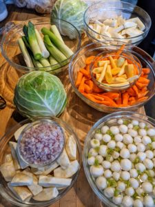 "All the vegetables are placed together as part of the ""mis-en-place."" It refers to having all the ingredients prepped and ready to go before cooking. The main course includes leeks, celeriac, carrots, parsnips, turnips, and cabbage."