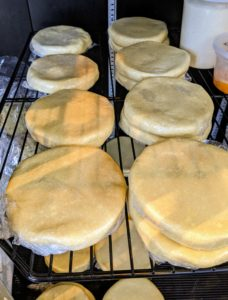 We made a lot of pate brisee discs in the refrigerator ready to roll out for our pie crusts. I have been making this pate brisee for many years and have perfected this recipe. It calls for two-and-a-half cups all-purpose flour, one teaspoon kosher salt, one teaspoon granulated sugar, two sticks unsalted butter, and a quarter to a half cup of ice water.