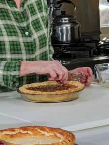 The filling includes unsalted butter, granulated sugar, dark corn syrup, eggs, bourbon, salt, pecans, and semi-sweet chocolate. Once the pie is made, decorate the top with whole pecan halves. Make this recipe along with me on the Food Network Kitchen App today - and your pie will keep until tomorrow's big feast.