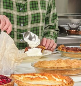 After the pie is completely baked and cooled, place a dollop of whipped cream on top and serve.