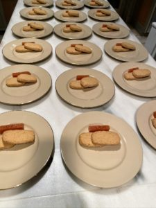 As my guests enjoyed their dinner, dessert is prepared in the kitchen - first brown butter shortbread cookies and a slice of quince paste are placed on each plate.