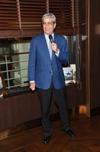 Rick addressed the guests and spoke about some of the ship's future itineraries. (Photo by Jamie McCarthy/Getty Images)