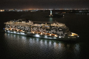 Here is a night view of the ship as it passes New York City's Statue of Liberty. (Photo courtesy MSC Cruises USA)