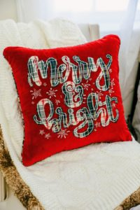 "For a whimsical touch, add holiday pillows from my Collection exclusively at Macy's. This ""Merry & Bright"" pillow is 18-inches square and made with cotton and a polyester fill."