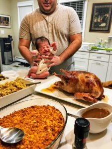 """Marquee senior art director, Benjamin Bloom, wanted to share this photo of """"my daughter's very first Thanksgiving - Bella Bloom. She turned three weeks old on Thanksgiving Day and was the center of attention at our family's meal."""""""
