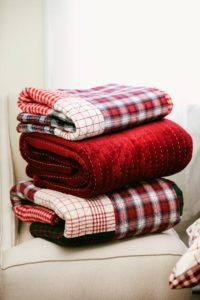 Don't forget to prepare your home for out-of-town friends and family. Keep your guests cozy with layered bedding and these throws from Macy's.