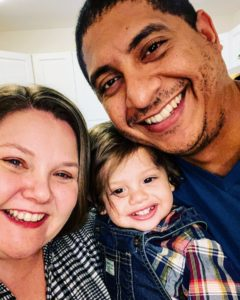 This holiday photo shows executive assistant, Cathryn Delarosa, her husband Hector, and their son Ethan on Thanksgiving Day.