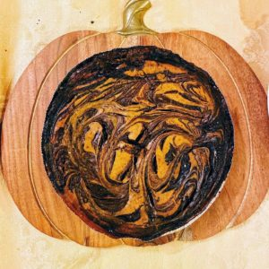 This is a pumpkin Nutella pie with a gorgeous swirl design.