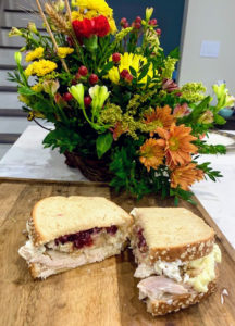 """Dorian says """"this is Craig's famous gobbler sandwich made from all the delicious leftovers."""""""