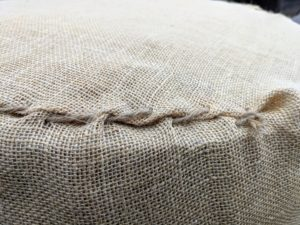 Chhiring is very good at sewing. Here's one side of the burlap cover already closed.