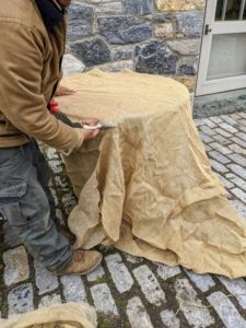 Chhiring cuts the burlap fabric to fit – one long piece that can completely wrap around the structure. Also called hessian, burlap is made in Pakistan, Bangladesh, and India from jute, a tall, grass-like plant grown for its strong fibrous stalks.