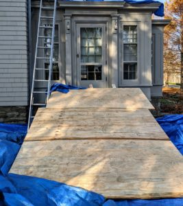 Boards are placed strategically over the stone stairs and all the nearby garden beds for protection.