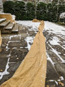 Rolls and rolls of burlap are needed to cover my hedges and shrubs each winter. After every season, any burlap still in good condition is saved for use the following year.