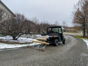 The gravel carriage roads are raked regularly, especially before any party, so they look neat and tidy. We attached four soft rakes to pieces of wood and hooked them up to the back of our Polaris ATV. The crew gets all four miles of carriage road raked pretty quickly.