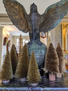 My home was filled with all kinds of trees. Here is a collection of bottle brush trees on the green marble table in my foyer - a woodland scene under my great falcon weathervane.