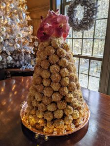 We also made a beautiful croquembouche - a French dessert consisting of choux pastry puffs filled with creme patissiere piled into a cone and bound with threads and threads of caramel. We topped ours with orchid flowers because we didn't make enough puffs.