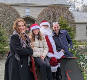 Anduin Havens, her daughter, Harper, and her husband Cedric, stopped for this photo with Santa.