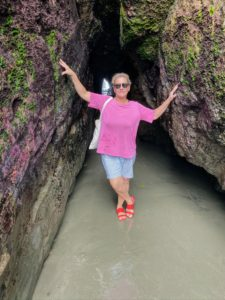 Here is Milena standing at the entrance of one of the caves. During the low tide, one can walk through and see the waves breaking inside.