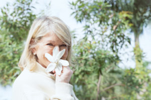 Here I am holding a fragrant gardenia flower. (Photo by Mary Dominguez)