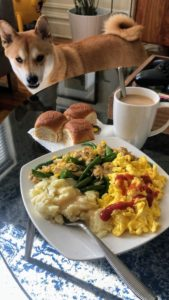 Marquee senior art director, Robert Romero, submitted this photo of his dog Charlie staring at all the tasty leftovers.
