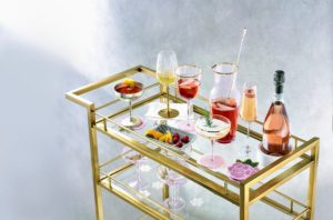 Prep your bar so it's ready to use when guests arrive. This Royal Blush Collection features pink barware pieces with a little pop of gold all your guests will love.