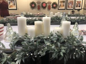 The entire room was decorated with holiday-themed pieces from my Collection at Macy's. This is my Silverwoods Mistletoe Candleholder Centerpiece and Garland. We also used my flameless candles in white.