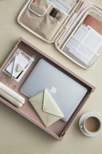 I love using trays to contain desk accessories and technology equipment. Not only do they look handsome sitting on a desk, but they make these items more portable and tidy. (Photo by Kana Okada)