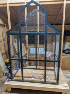 "Here is the cage sitting on its table. The table is 10.5"" off the ground. Directly below the cage sits a base that is 5' by 37.5"" that gives 6"" all the way around the cage. This base holds the birds' bedding and the catch pan to make cleanings easier."